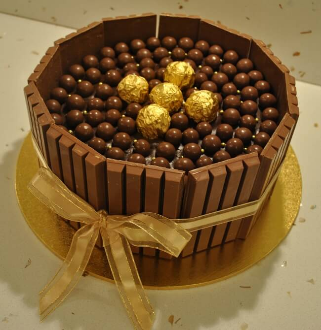 1 Kg Chocolate Supreme Delight Cake - cake with Kitkat, Ferraro and Cadbury shots